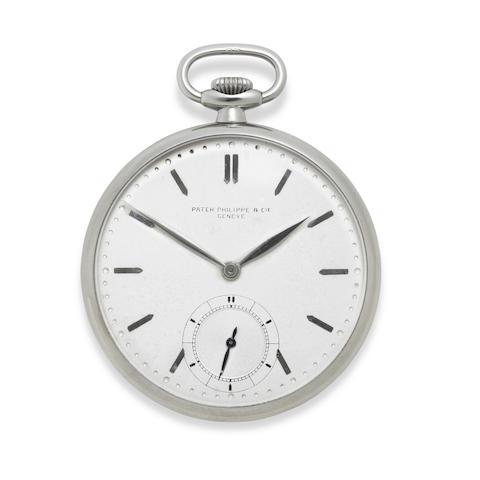 A rare stainless steel open face dress watch