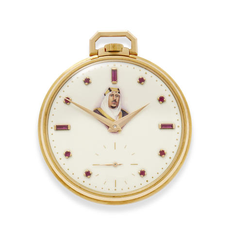 A very fine 18K rose gold commemorative watch with ruby