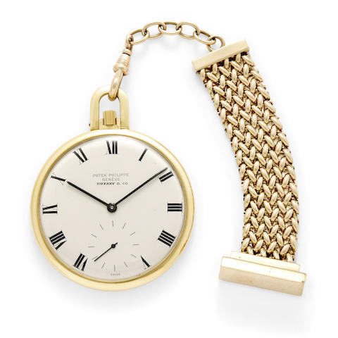 A fine 18k gold open face dress watch and a gold fob
