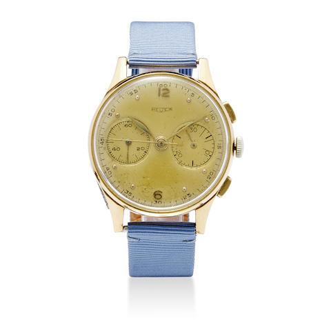 Heuer. An 18K gold chronograph wristwatch