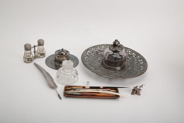 A white metal double inkwell in the form of a pair of opera glasses