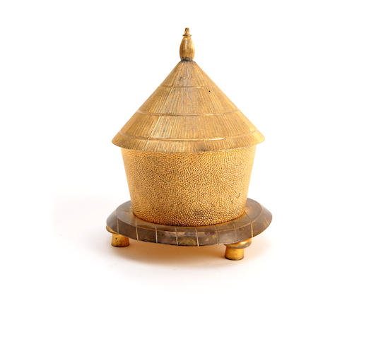 A 19th century gilt-brass inkwell in the form of a hut