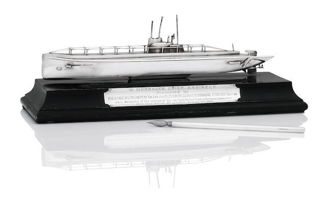 Of Naval interest; A silver mounted desk stand in the form of a German U-Boat