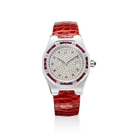 An 18K white gold ruby and diamond set lady's calendar wristwatch