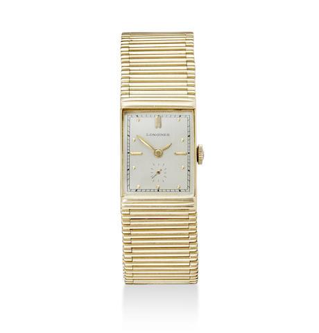 Longines. A fine 14K gold bracelet