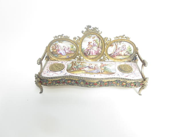 A Viennese silver-gilt and enamel inkwell in the form of a sofa