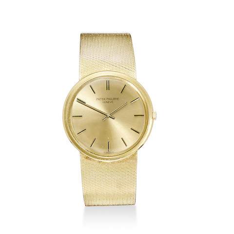 An 18K gold automatic bracelet watch