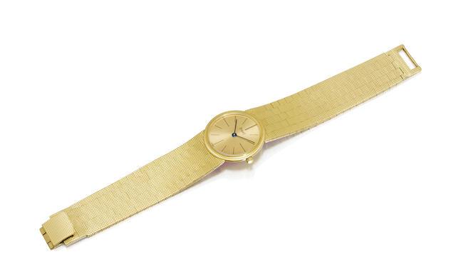 An 18K gold bracelet watch