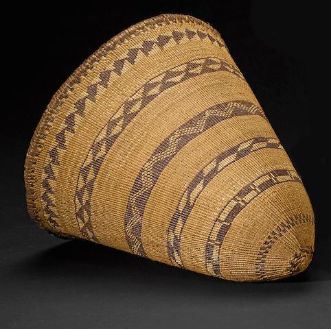 A Pomo twined polychrome burden basket