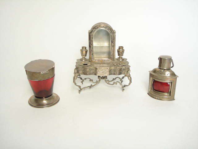 A silver inkwell in the form of a hallstand