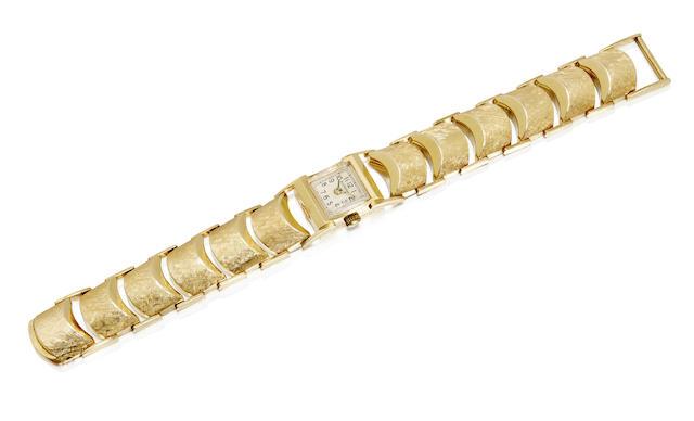 A 14K gold bracelet watch
