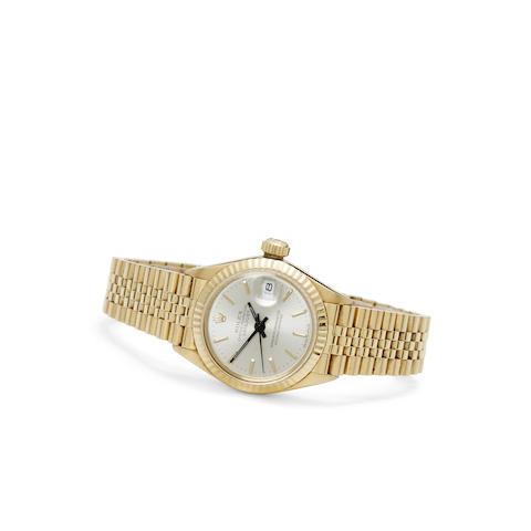 Rolex. A fine 18K gold lady's automatic center seconds bracelet watch with date
