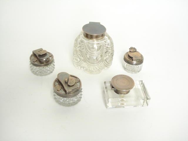 A group of five silver mounted glass inkwells