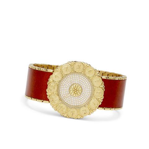 Buccellati. An 18K gold brown leather and diamond-set Eliochron bracelet watch