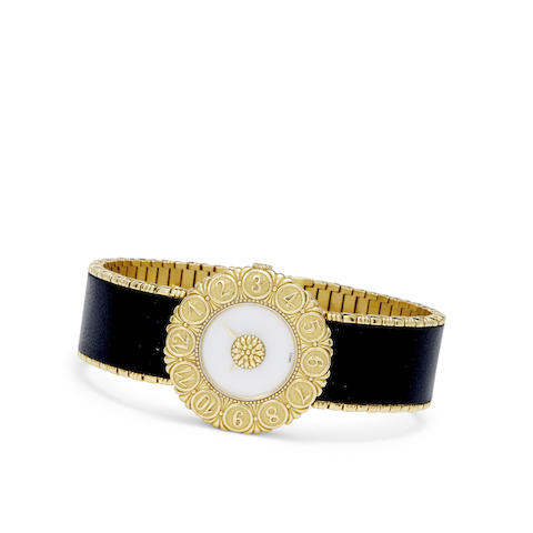 An 18K gold and black leather Eliochron bracelet watch