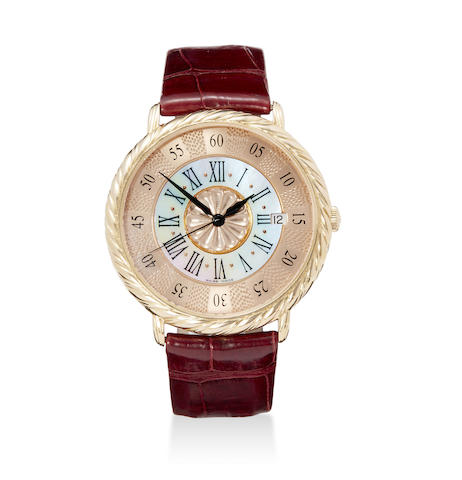An 18K rose gold and mother of pearl automatic Audachron wristwatch