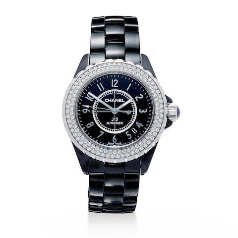 A fine black ceramic and diamond automatic center seconds wristwatch with date