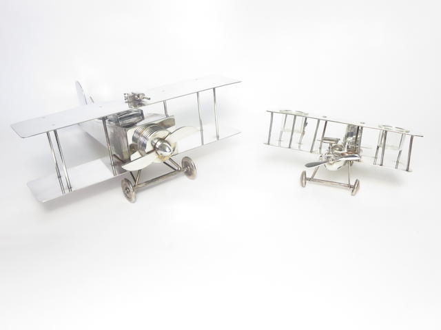 Two electroplated inkwells in the form of biplanes