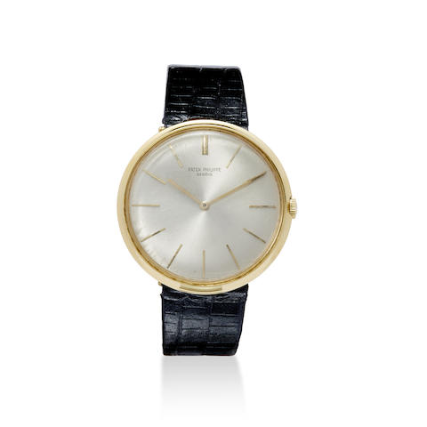 An 18K gold wrist watch with concealed lugs