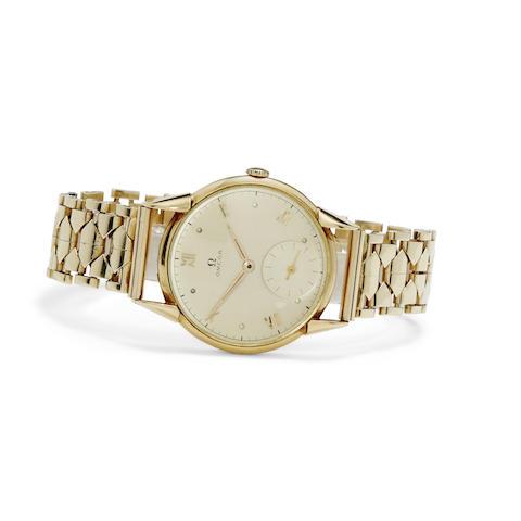 Omega. An 18K gold wrist watch and a 14K gold bracelet