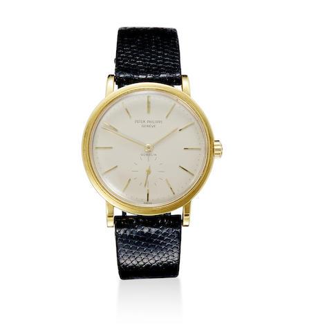A fine 18K gold automatic wristwatch with box and original Guarantee Certificate