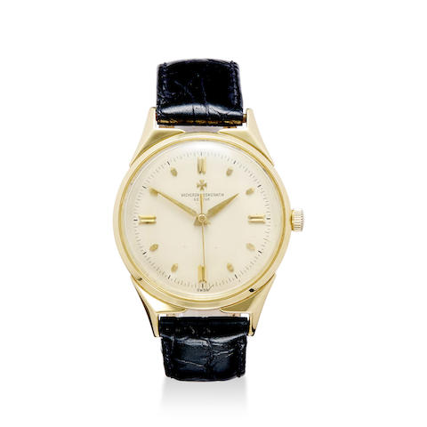 A fine 18K gold center seconds wrist watch with hack feature