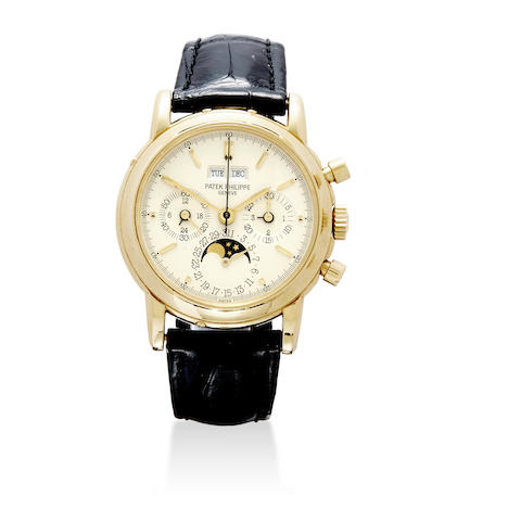A fine 18K gold chronograph wristwatch with perpetual calendar and moon phase