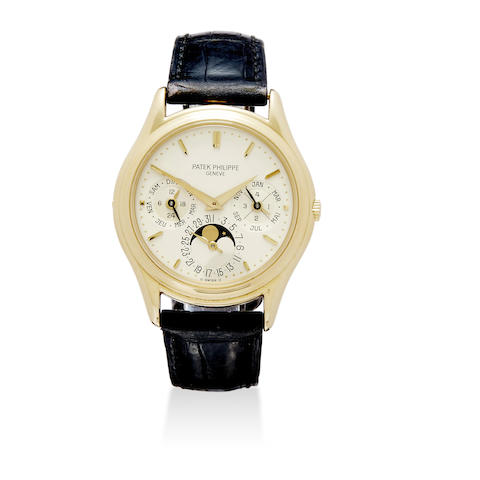 A fine 18K gold automatic wristwatch with perpetual calendar and moon phase