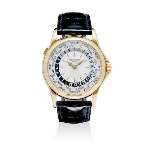A fine 18K gold automatic wristwatch with world time indications