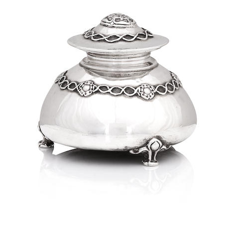 a silver inkwell