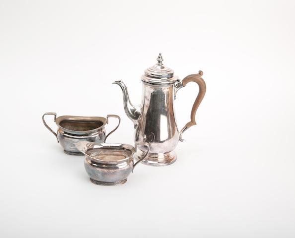 A three piece silver coffee service