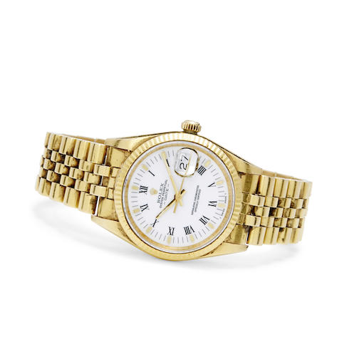 An 18K gold automatic wristwatch and bracelet