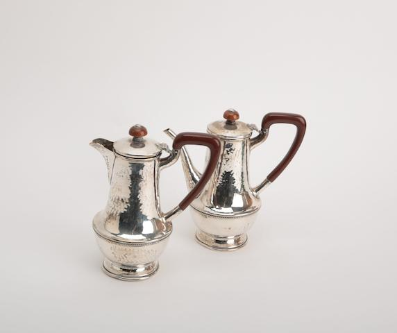 A silver coffee pot and hot water pot