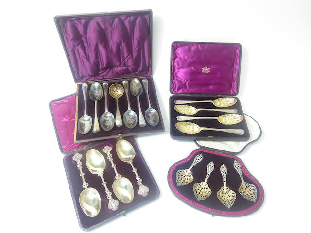A collection of cased serving spoons