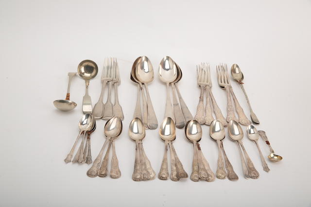 A small collection of silver flatware