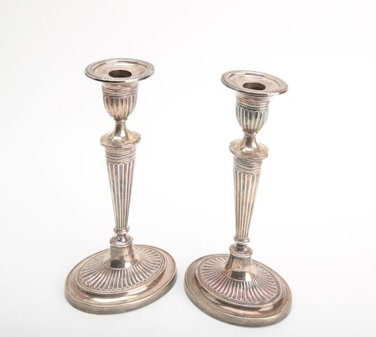 A Victorian pair of silver candlesticks