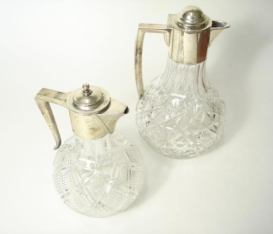 Two silver mounted glass claret jugs