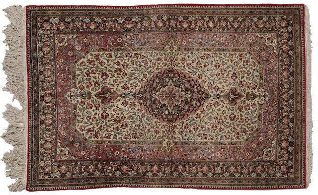 A silk Qum rug