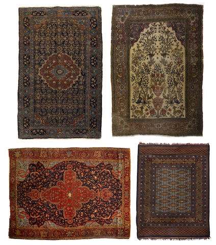 A group of four Persian and Pakistani rugs