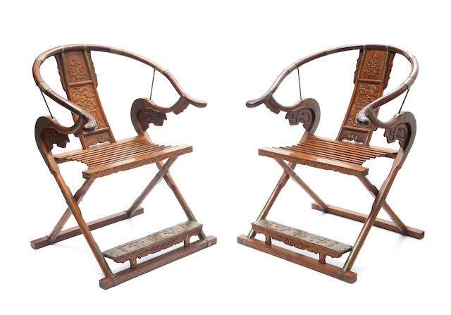 A pair of Chinese folding armchairs