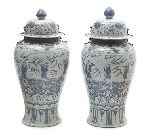 A pair of Chinese blue and white iron mounted porcelain covered tea jars