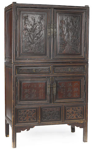 A carved two-section double door wood cabinet
