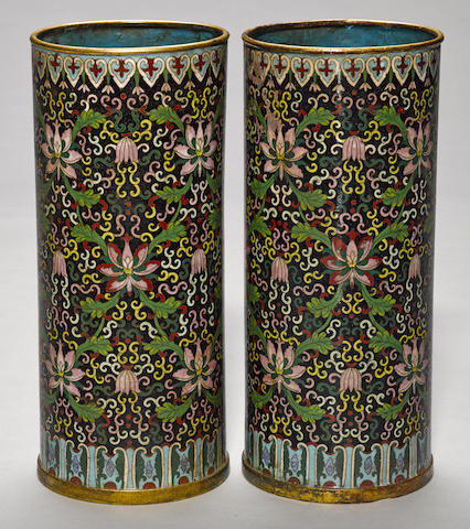 A pair of black ground cloisonné enameled metal cylindrical vases