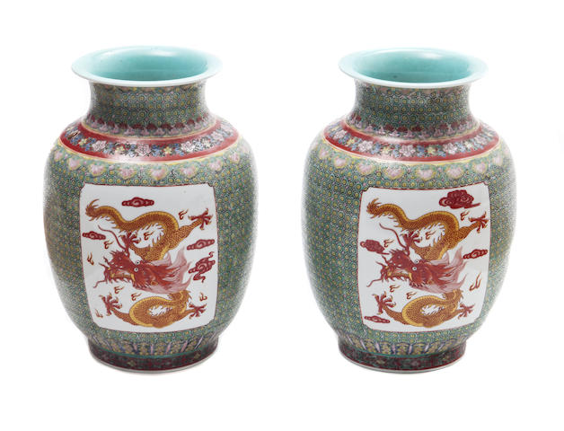 A pair of Chinese polycrome vases with dragon designs