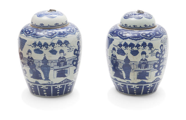 A pair of Chinese blue and white iron mounted covered jars