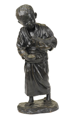 A Japanese patinated bronze of a boy