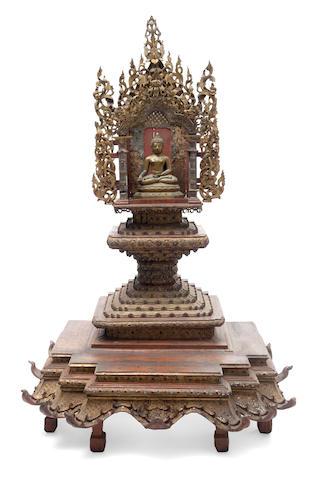 A Thai shrine with a seated Buddha