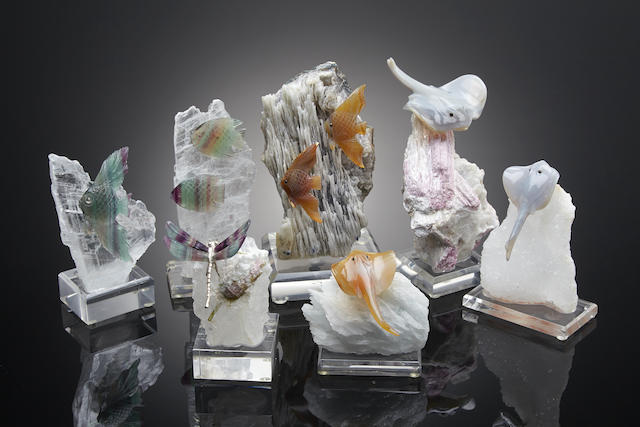 Grouping of lapidary sea animals and a dragonfly