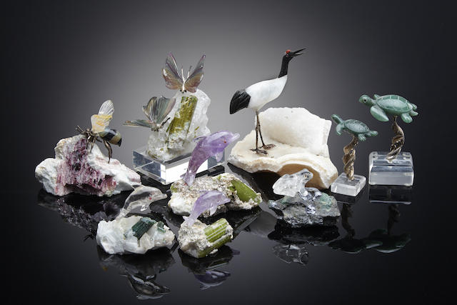 A group of nine carved gemstone animals and insects