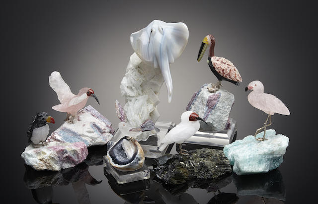 A group of seven carved gemstone shore birds and one stingray